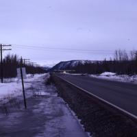 Plane landing on highway, Tok, Alaska. 1982.