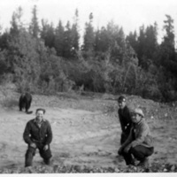 Three men and a bear during the construction of the Alaska Highway.
