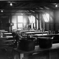 Soldiers in a mess hall preparing meals, probably in Aleutians