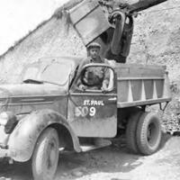 Serviceman with dump truck